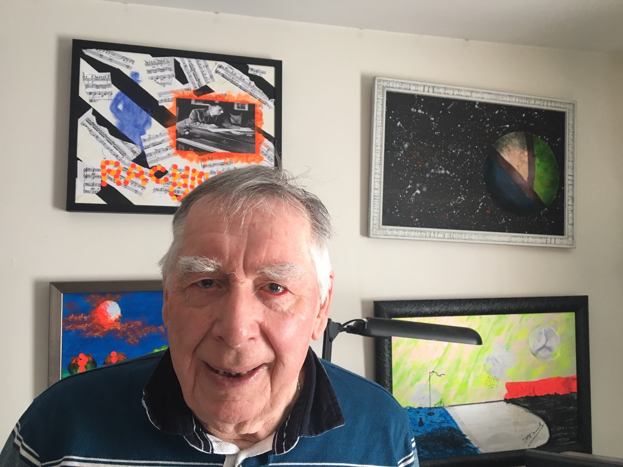 Douglas Burke with some of his collages.