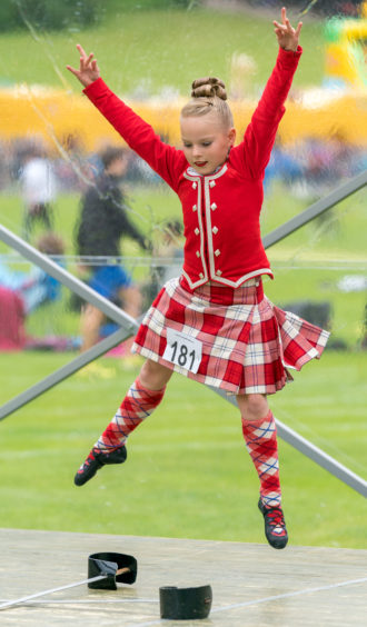 Eilidh Smith performs the sword dance for the judge.
