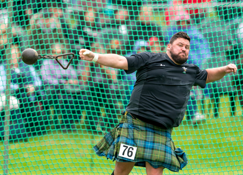 Sinclair Patience throws his weight for distance during the Highland Games.
