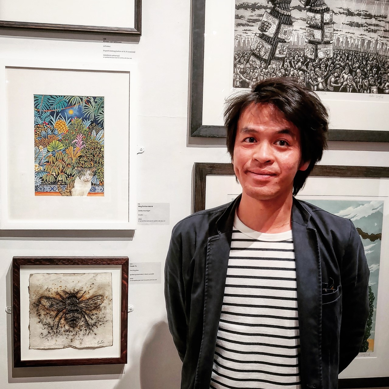 Frank To with his painting King Bee at the prestigious London art show.