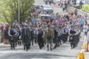 Halkirk Highland Games chieftain, Lord Thurso, (front right) and president Alistair Swanson, (front left), lead the massed pipebands from Thurso and Wick, along with officials and members of the public from the centre of the village to the games field.