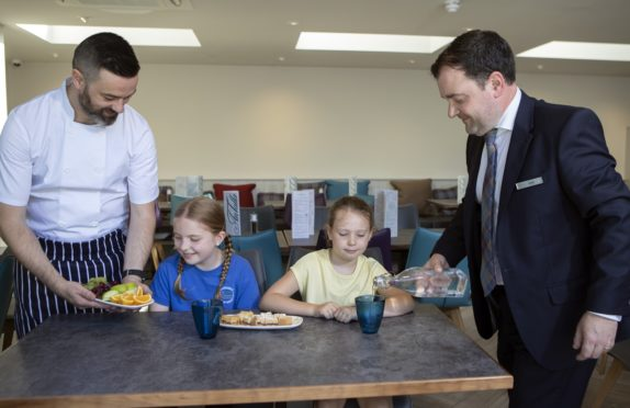 Head chef Stuart Matheson and general manager Robert Day serving some treats to Amelie Rae Annie-Jane Simpson