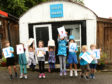 Local children at the shed in Dalmally where the charity was founded celebrate Mary's Meals feeding 1.5 million children. photo:Kevin McGlynn