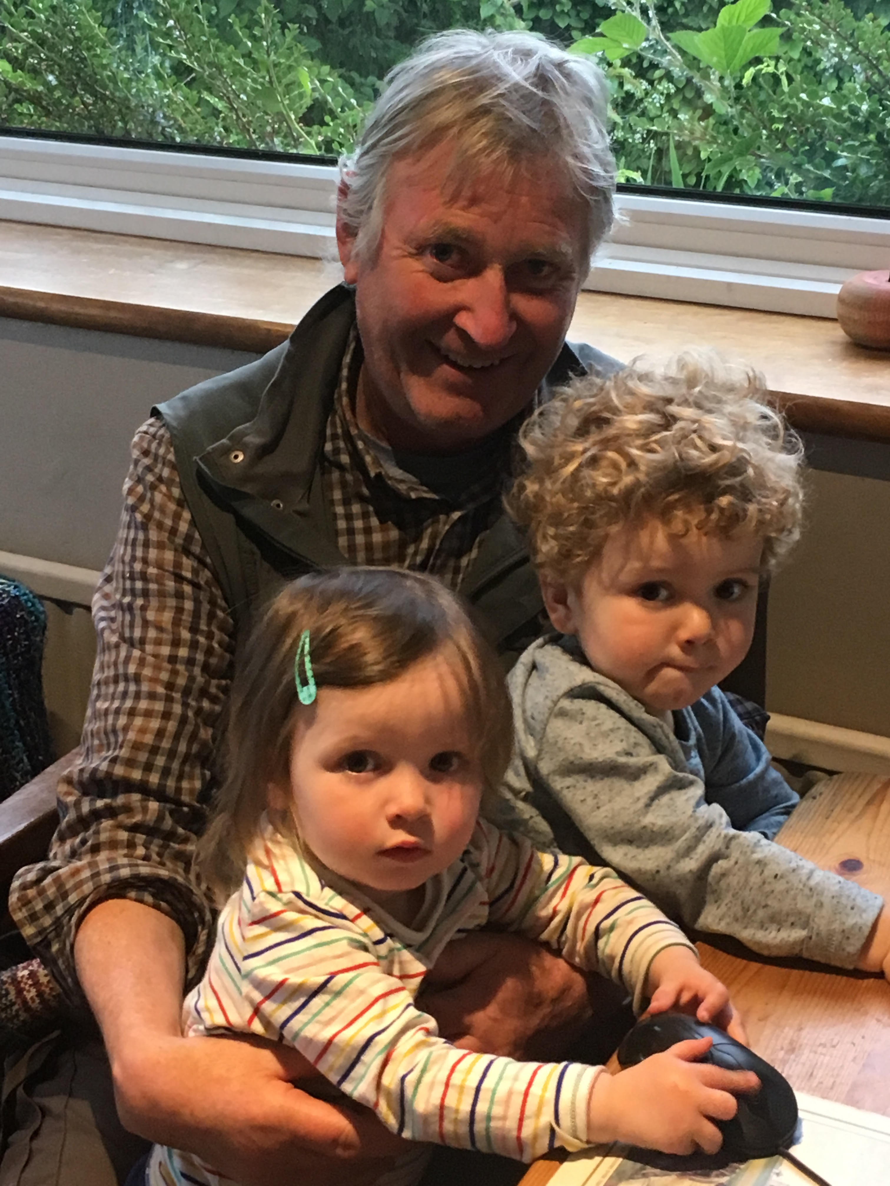 Author John Miles with his grandchildren Emily, two, and Samuel, two and a half.