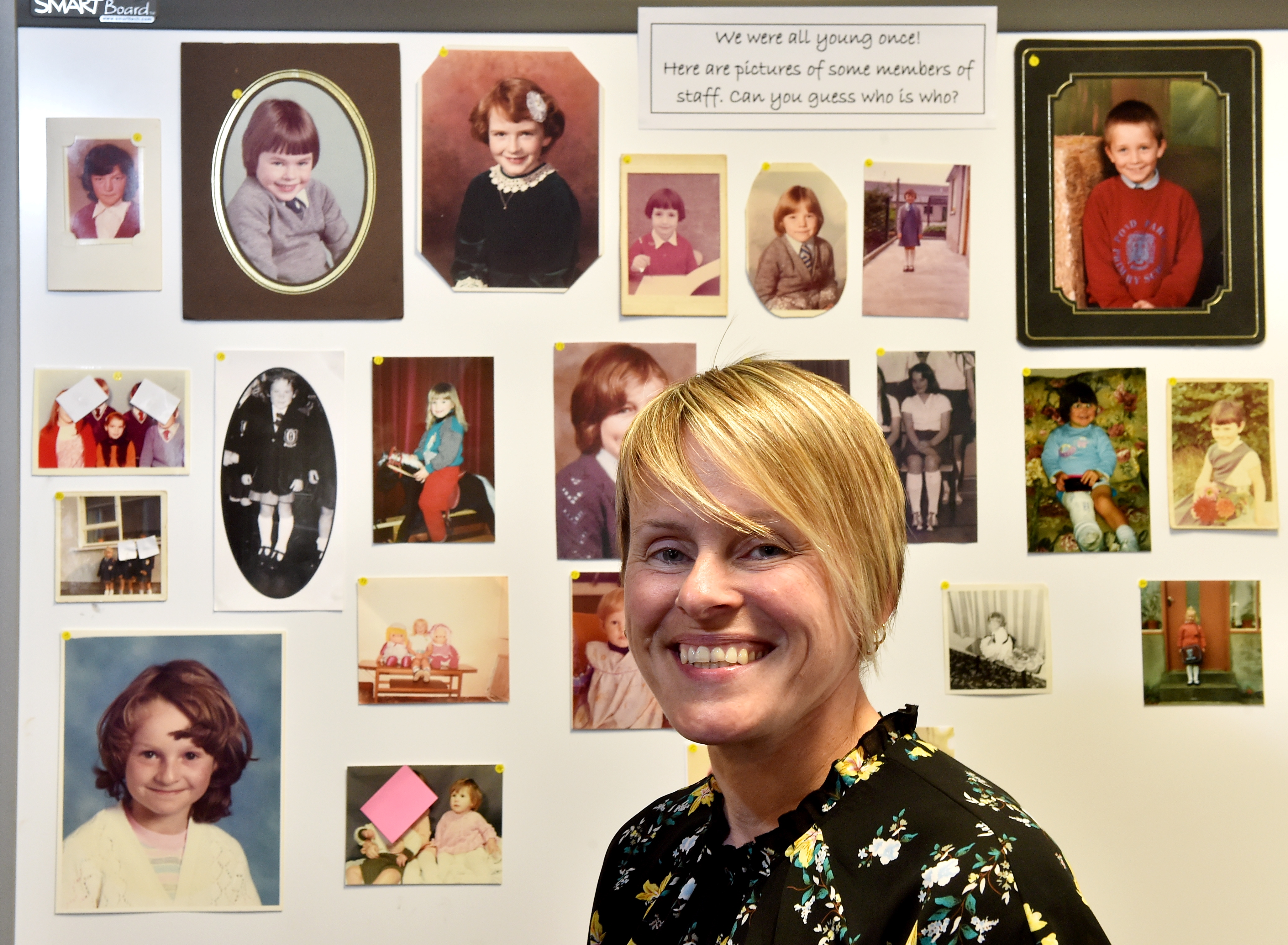Lochpots deputy head Heather Milne with a collection of photographs of staff when they were in school.