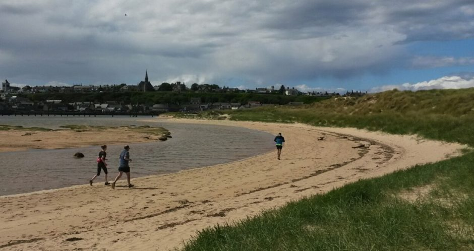 Runners on Lossiemouth beach