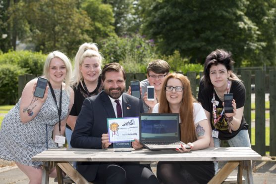 31/07/19 Tiffy Burnett, Mega Rhynd, Councillor John Wheeler, jason Urquhart, ,Megan pirie, (Children's rights Champion), Renee Bertram;   Aberdeen City Council has formally adopted a new app to help care-experienced young people make their voices heard.At an event today (Wednesday 31 July) at Westburn Resource Centre, staff and young people were among the audience giving their feedback on the Mind of My Own app which has been on trial since March.The app enables young users to make their voices heard and make decisions on their lives by saying how they are feeling, what support they need and to tell their care worker about the things that are important to them.