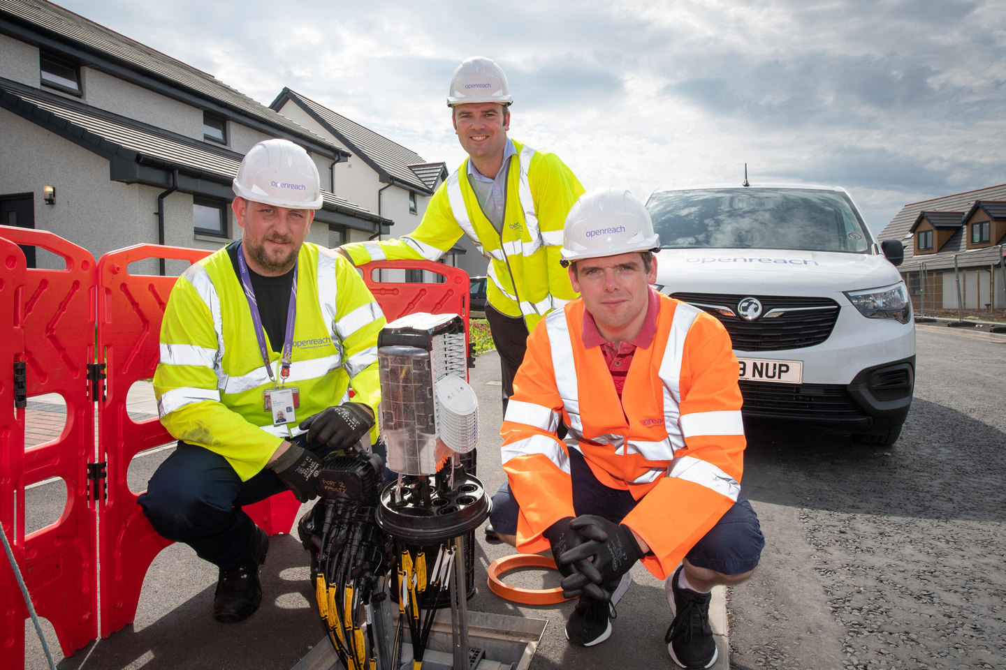 Openreach engineer Will MacGillivray and programme manager Ben Dempster show Moray MP Douglas Ross some of the new full fibre broadband hardware on a new housing estate in Buckie.