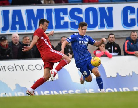Ben Armour challenges Aberdeen's Andy Considine.