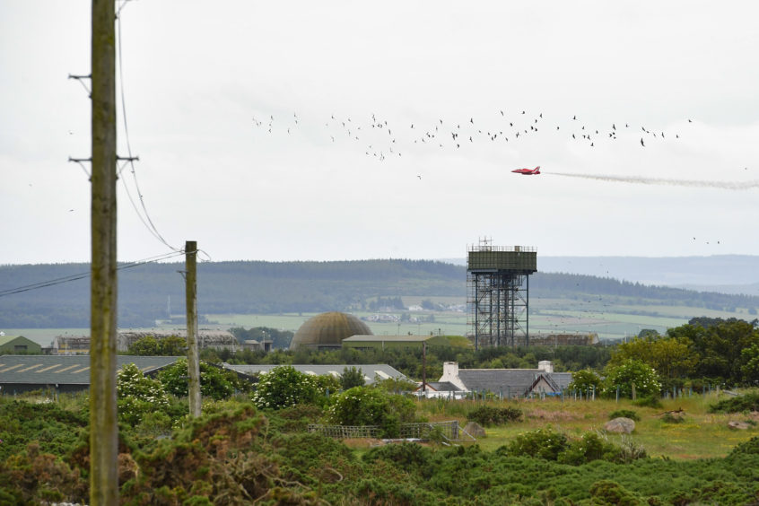 Red Arrows perform over RAF Lossiemouth.