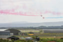 Red arrows perform over RAF Lossiemouth today.  Pictures by JASON HEDGES