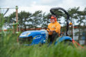 A grass cutter is pictured at Doocot Park, Moray.