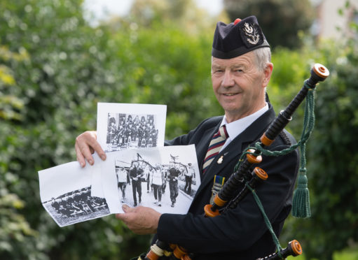 Gordon Duncan with photographs showing memories of his 26-year career with the Territorial Army.