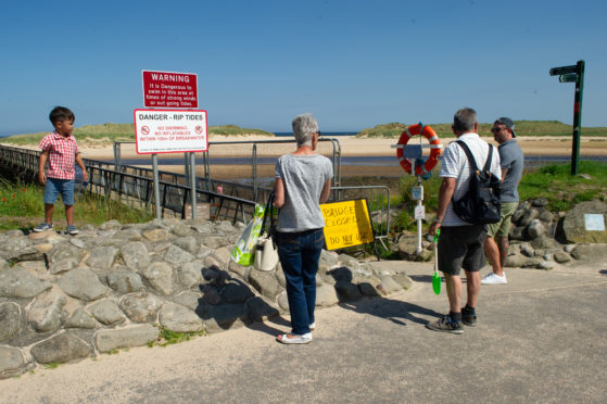 Sun-seekers turned away from Lossiemouth's East Beach due to the bridge closure.