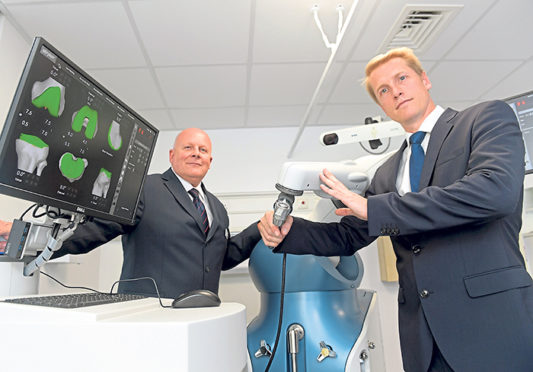 Hospital executive director Stuart Storrie and consultant orthopaedic surgeon Martin Mitchell