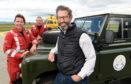 Andy Elwood with aircrew paramedics Gwen Bain and Terry Cheetham at the Scottish Ambulance Service air ambulance base at Inverness airport