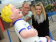 Club Captain Carl Tremarco with Dawn Cowie, Highland Fundraising Officer with Archie photographed with Oor Willie.