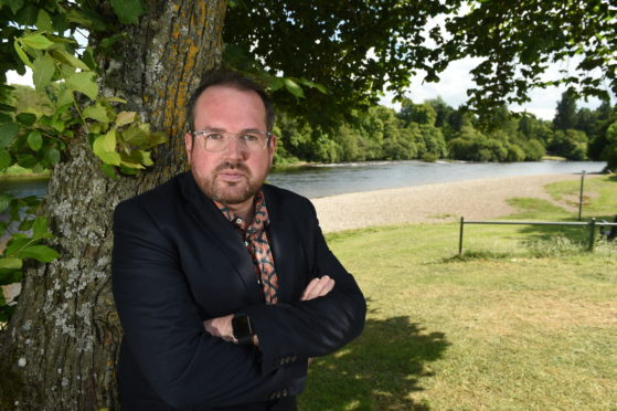 Inverness Councillor Ron MacWilliam at the proposed site of the public art on the River Ness in Inverness.