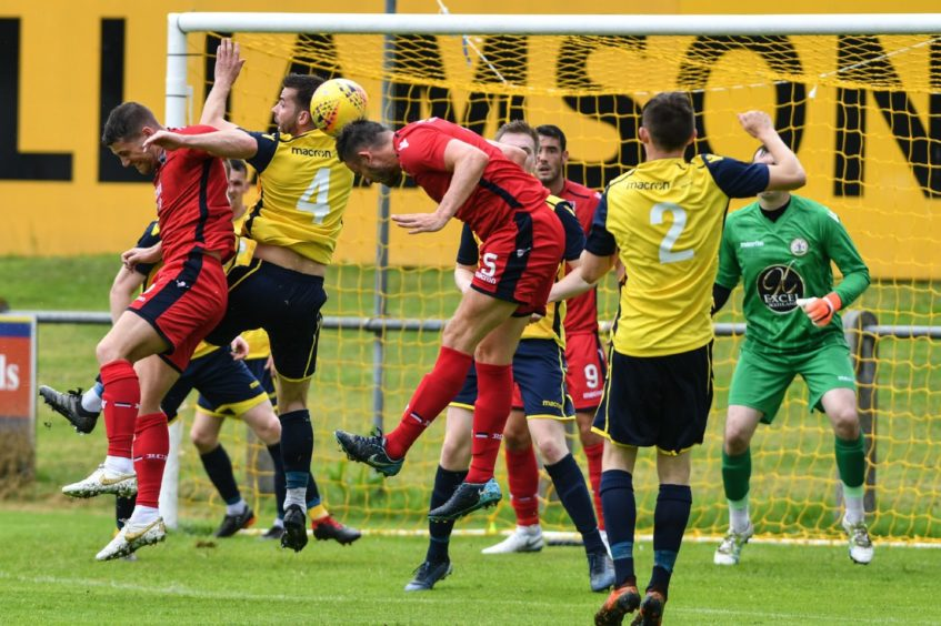 Forres Ross MacPherson battles with Ross County   Pictures by JASON HEDGES