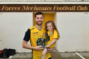 Ross MacPherson with his testimonial match trophy and daughter Jesse.   Picture by Jason Hedges