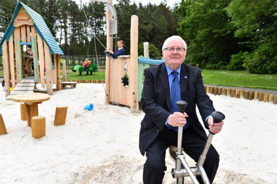 Councillor Norman Smith officially opens the new play park at Aden Country Park.