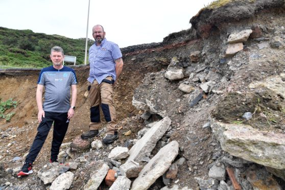 Councillors Ross Cassie (L) and Mark Findlater at the scene of the coastal erosion near Banff bridge.