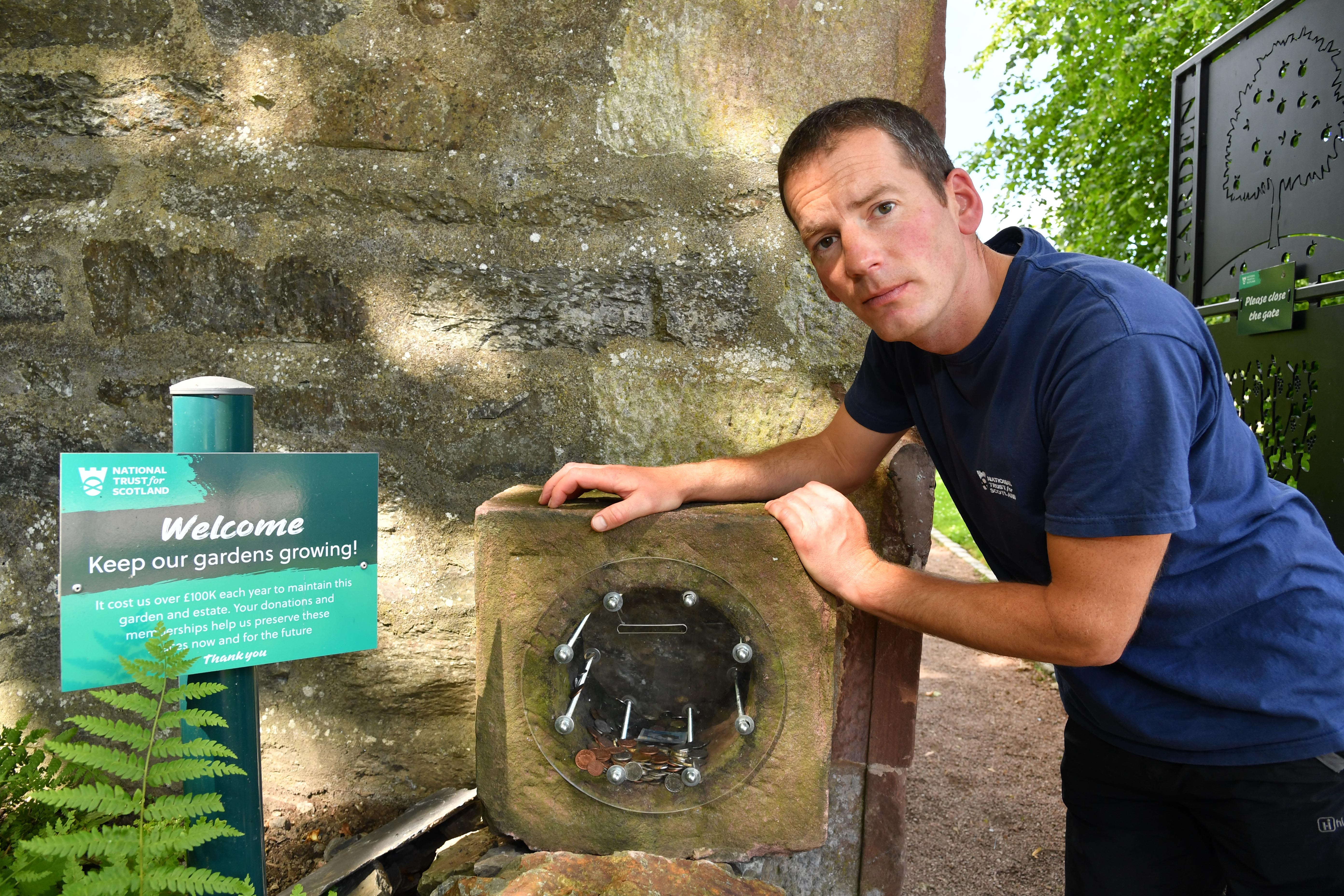 Head gardener Gordon Thomson with the donation box that was targeted.