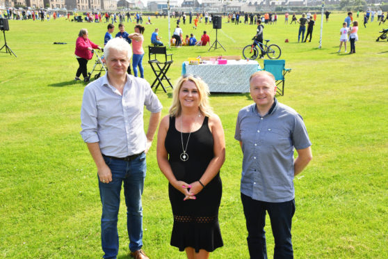 PACT COMMITTEE MEMBERS (L TO R) ALAN FAKELY,SECY,DIANNE BEAGRIE,CHAIR AND GRAHAM MACKIE,VICE CHAIR AT THE FOOTBALL EVENT.