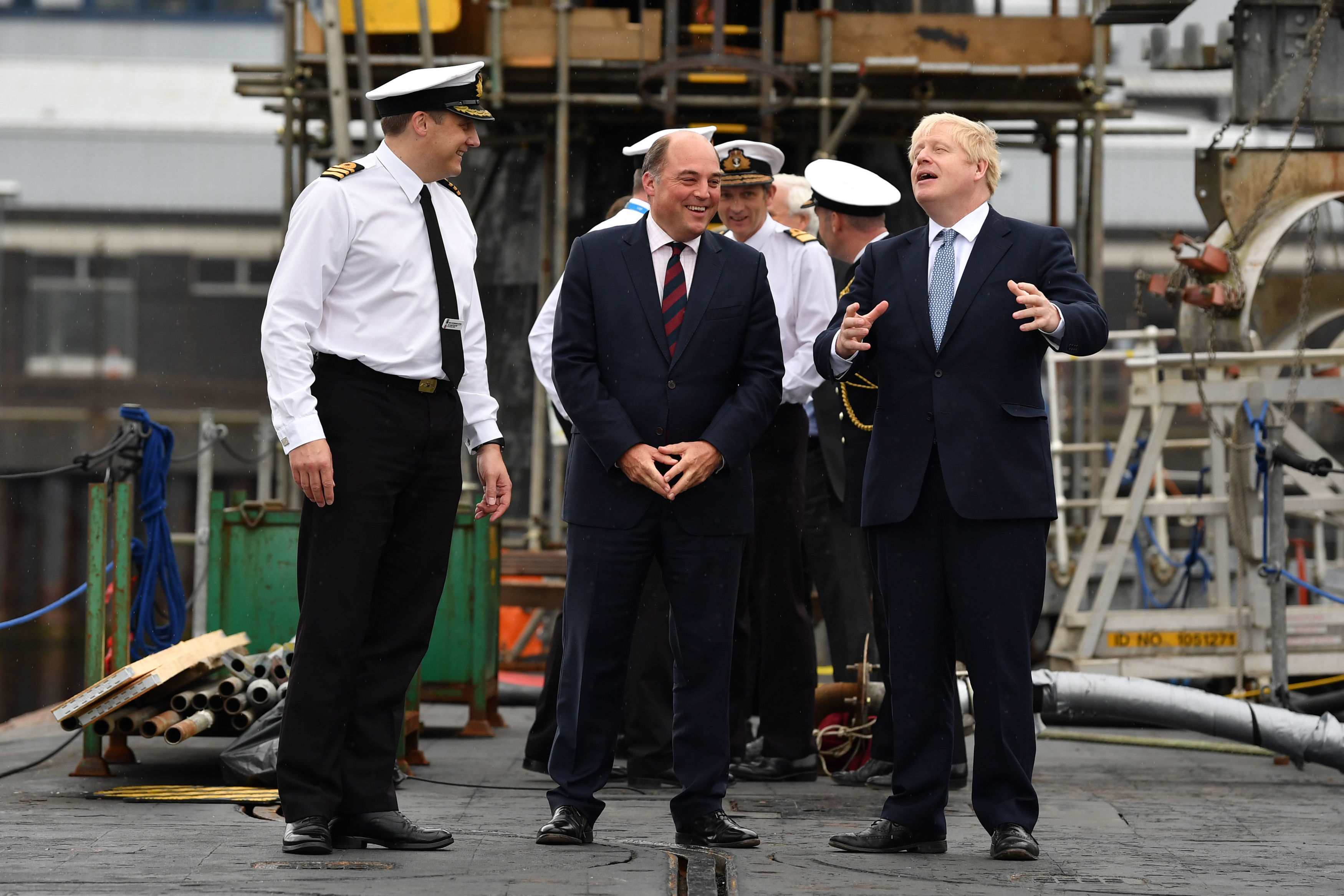 Prime Minister Boris Johnson visits HMS Victorious with Defence Secretary Ben Wallace accompanied by Commander Justin Codd at HM Naval Base Clyde in Faslane, Scotland.