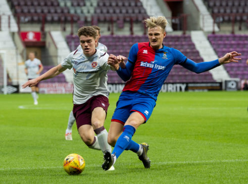 08/07/19 ANGUS BEITH BENEFIT MATCH HEARTS v INVERNESS CT TYNECASTLE PARK - EDINBURGH Hearts' Euan Henderson (L) competes with Coll Donaldson