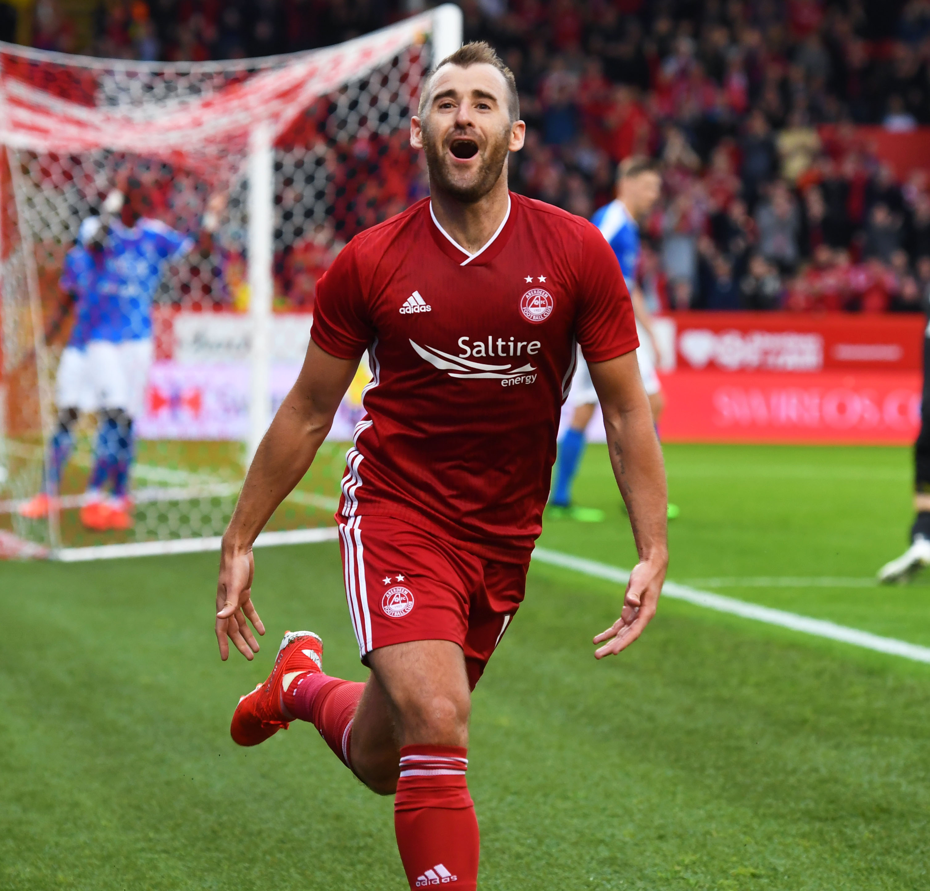 Niall McGinn wheels away in delight after making it 1-0 to Aberdeen.
