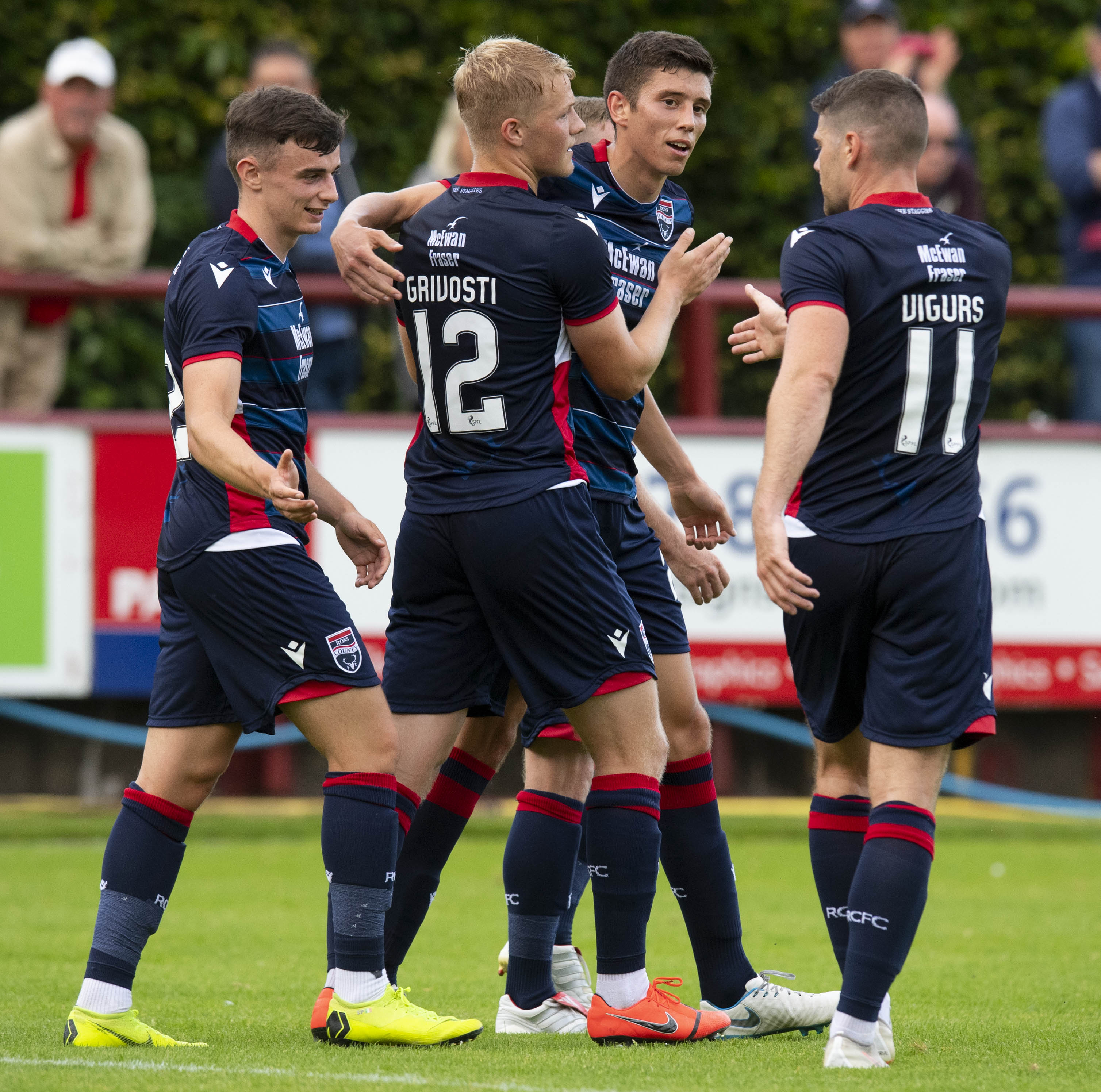 The Ross County players celebrate Ross Stewart's opening goal