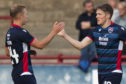 Ross County's Blair Spittal celebrates his goal to make it 4-0 with Harry Paton.
