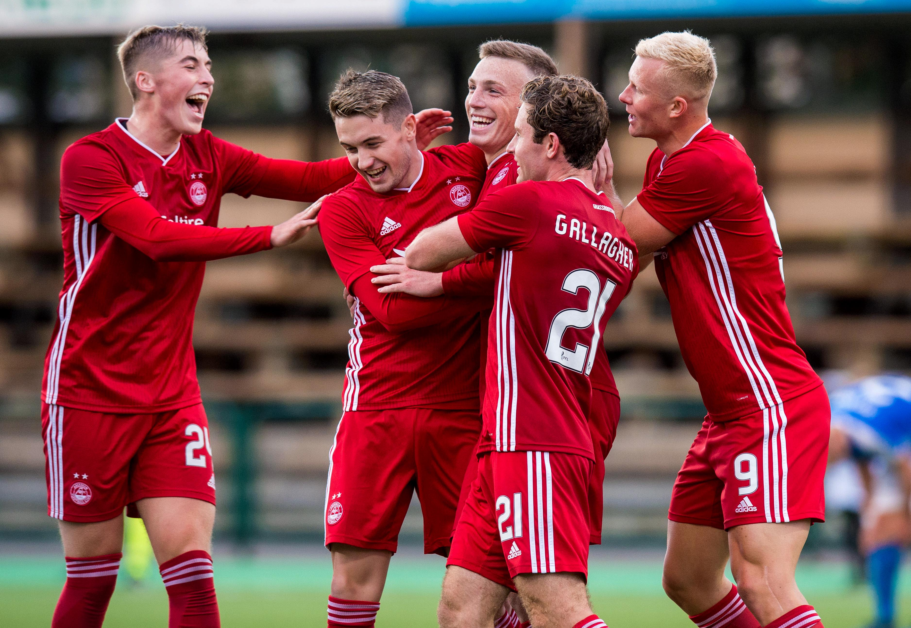 Lewis Ferguson celebrates with his teammates after making it 2-1 to Aberdeen.
