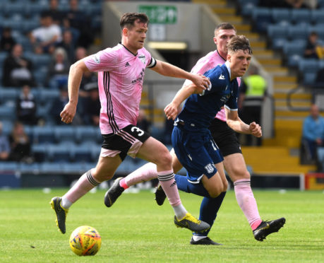 Peterhead's Patrick Boyle in action with Dundee's Josh Mulligan.