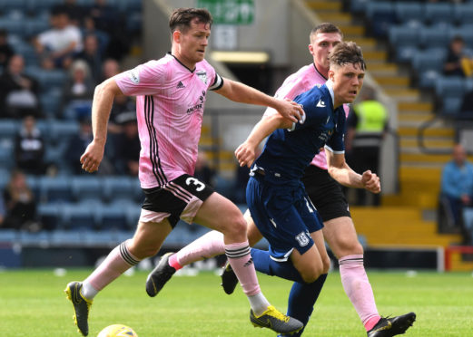 Josh Mulligan, right, in action for Dundee against Peterhead in last season's League Cup.