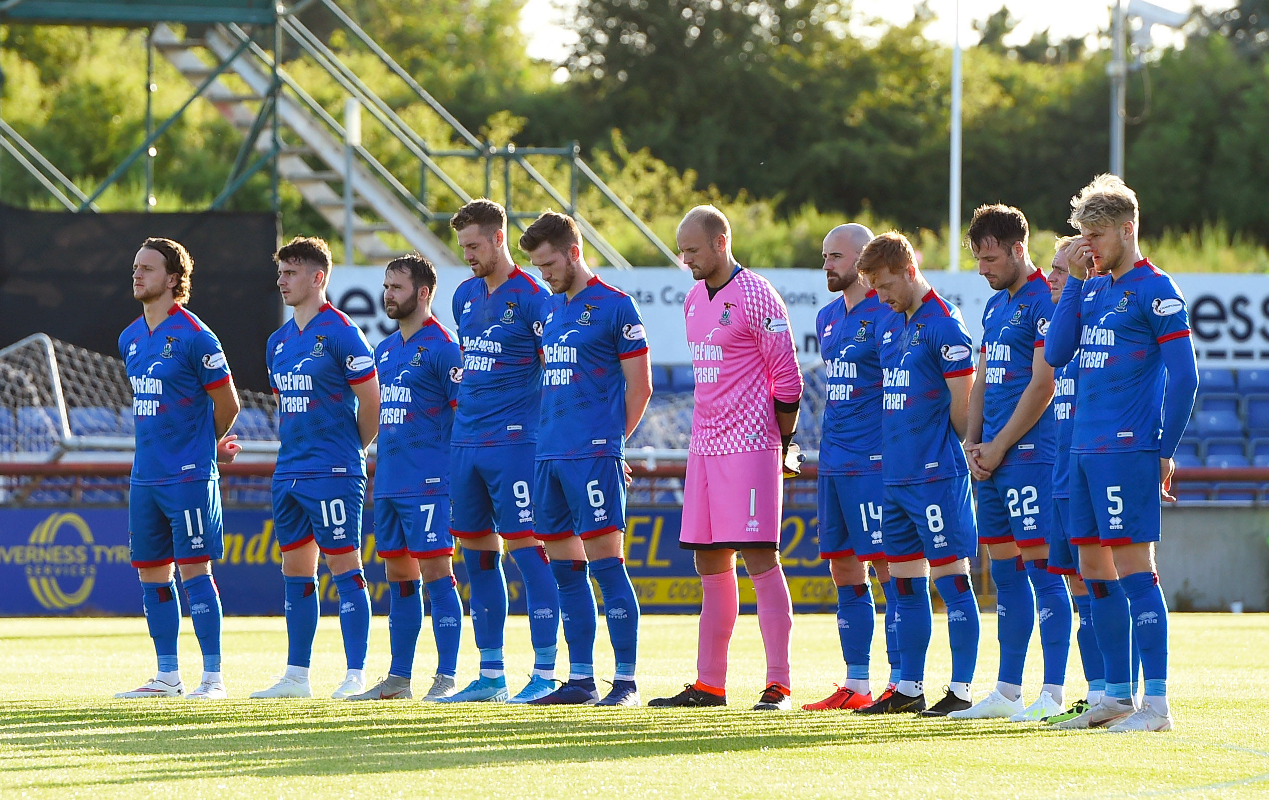 The Inverness players observe a minutes silence for former youth team coach, John Beaton