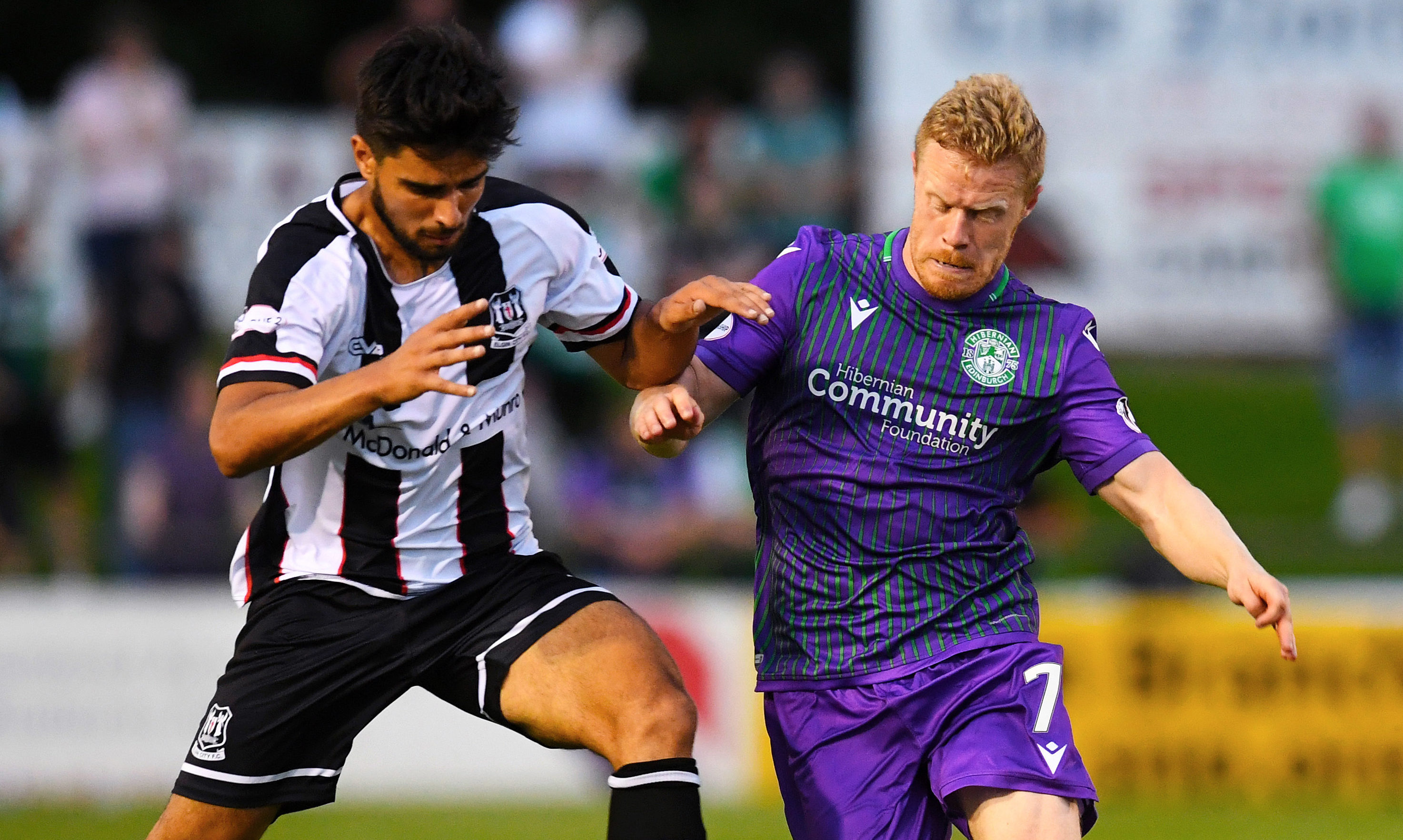 Rabin Omar, left, in action for Elgin against Daryll Horgan of Hibs.