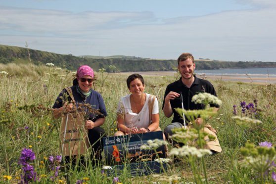 St Cyrus Reserve Manager Therese Alampo, MSP for Angus North and Mearns Mairi Gougeon and Reserve Assistant Simon Ritchie launch Take 3 For the Sea