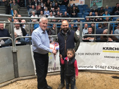 Steven Smith and daughter Lily with George Mearns, left, from Turriff Agri Parts.