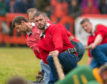 Elgin compete in the tug of war contest.