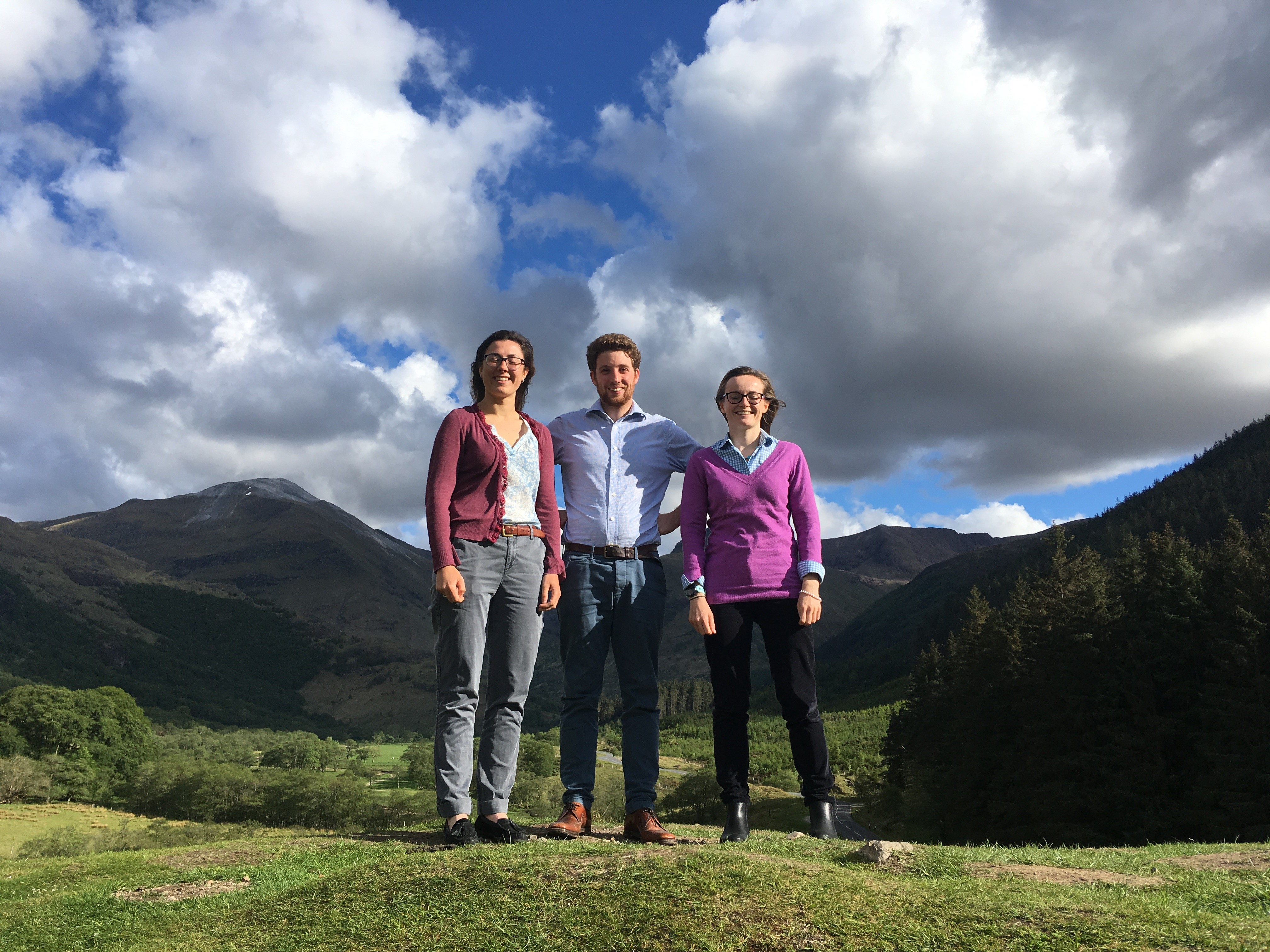Pictured with part of the Tranter's Round ridgeline in the background are three of the ambitious team (from left) Penny Coles, Calum Hogg ad Heledd Rheinallt.