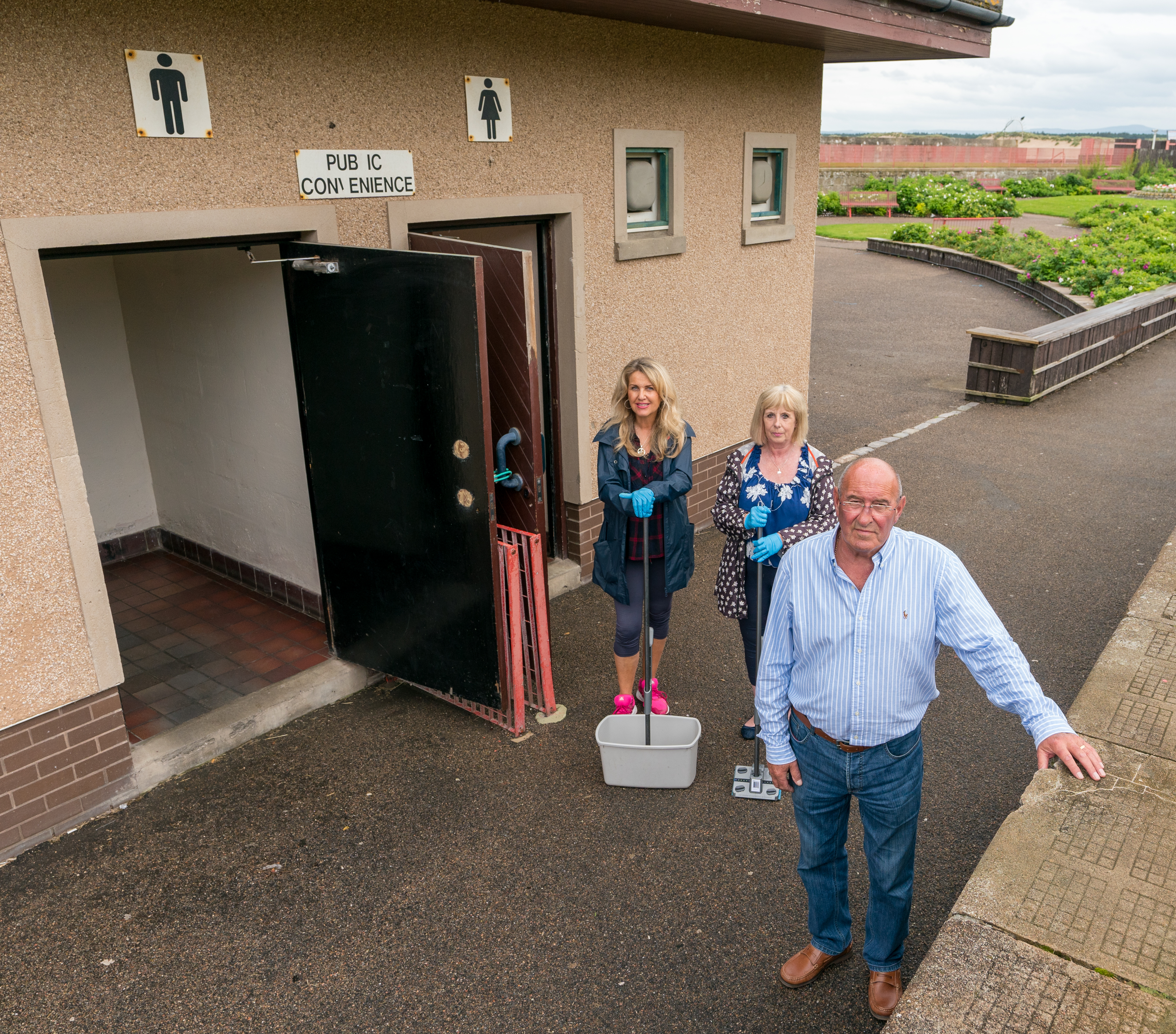 Chairman Mike Mulholland, Vice Chair Carolle Ralph and Fiona Campbell at the Public Toilets which have been left in disgraceful states.