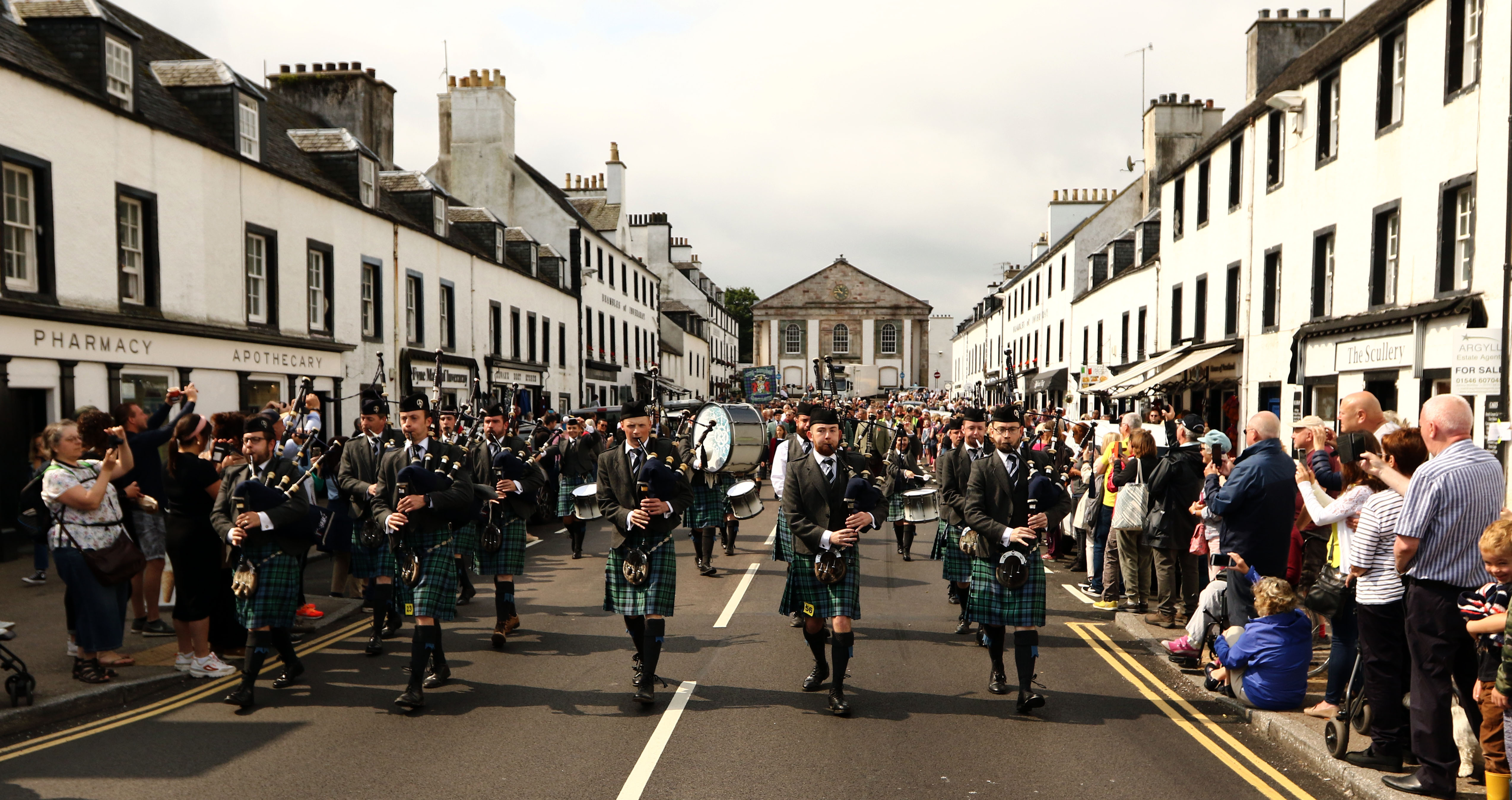 Inveraray and District Pipeband European Champions lead the parade down the main street to the games field.