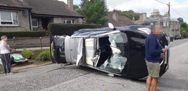 A motorist had a lucky escape when their car overturned.