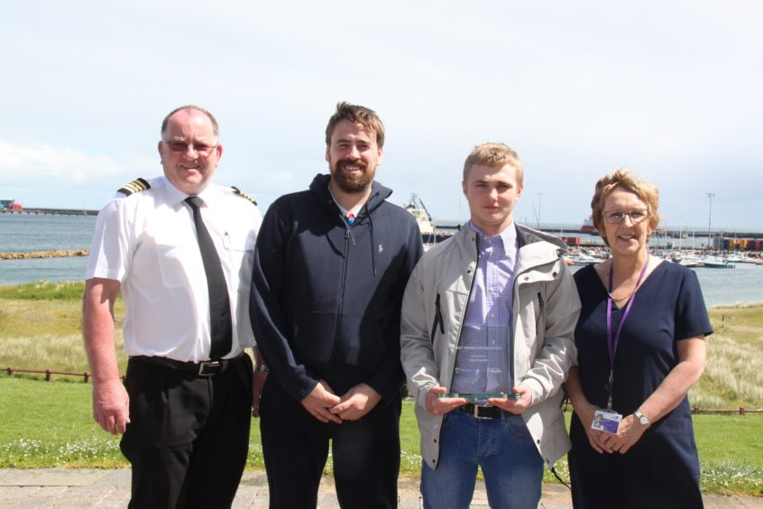 Harbourmaster John Forman, skipper Alexander Buchan, winner Kyle Rossiter and Centre manager Linda Hope