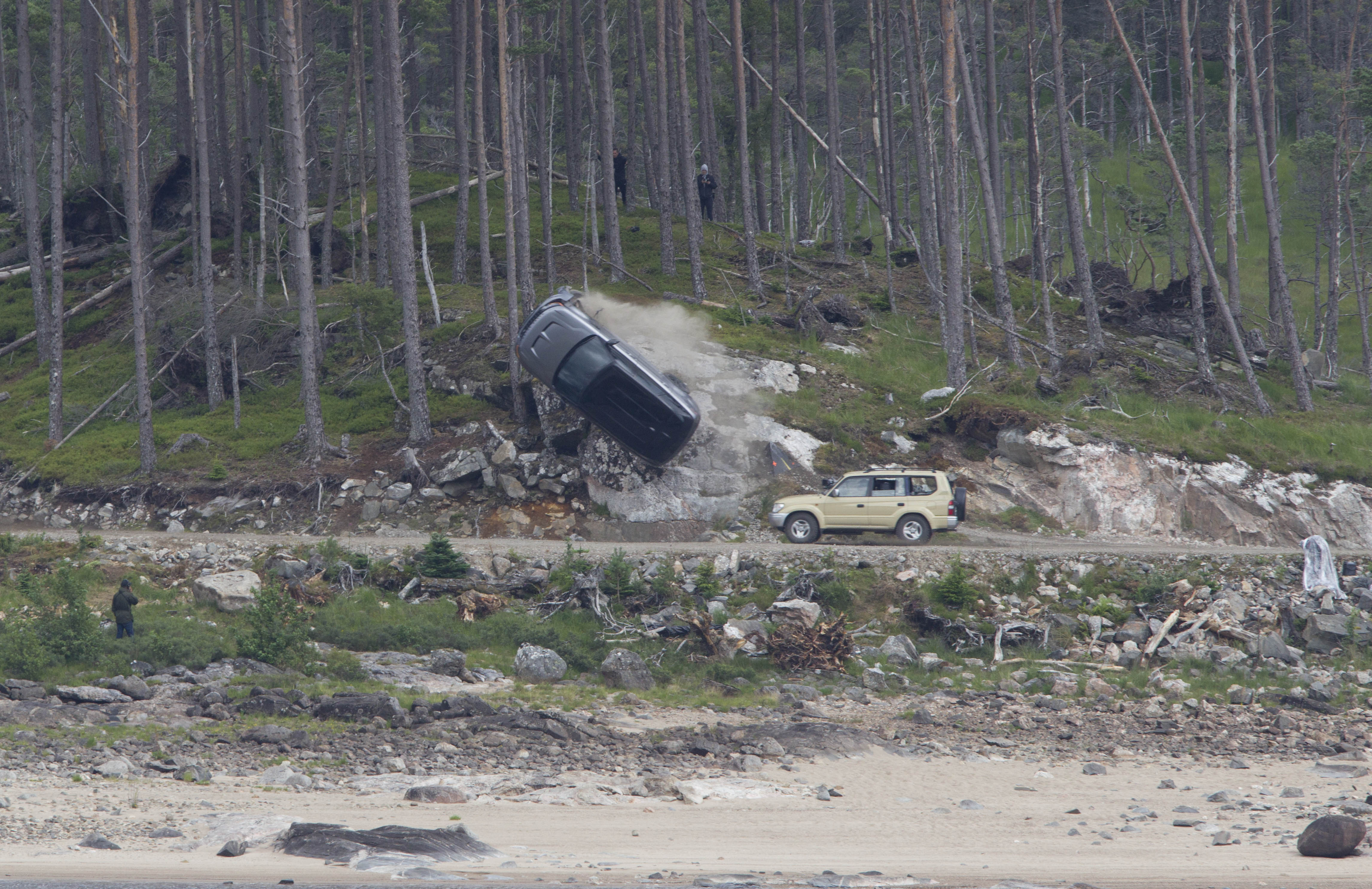 Bond takes to the highland roads with car crash stunt near laggan as the film crew set up with chase stunt cars and crash.