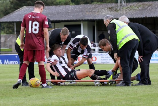 Daniel MacKay gets stretchered off with a damaged left ankle injury.