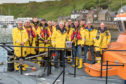 80-year-old Alexander Main presenting £750 to Thurso Lifeboat.