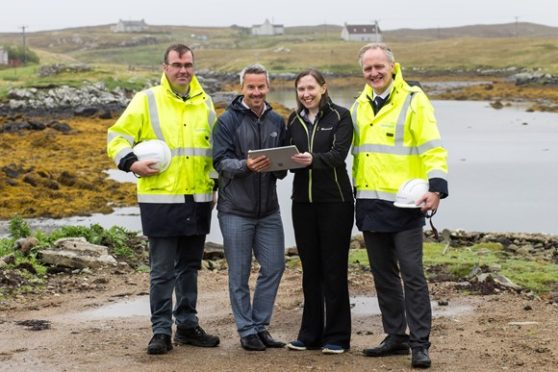 Launching a 100% full fibre network on Grimsay in the Outer Hebrides are DI MacDonald, patch manager for Western Isles; Rob Thorburn, partnership director; and Kevin Murphy, managing director of fibre and network delivery, all Openreach;  and Andrea Rutherford, head of telecoms policy, Highlands and Islands Enterprise (second from right). Photo: Jennifer Campbell/HIE